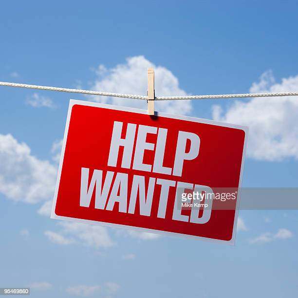 help wanted on clothes line - help wanted sign stock photos and pictures