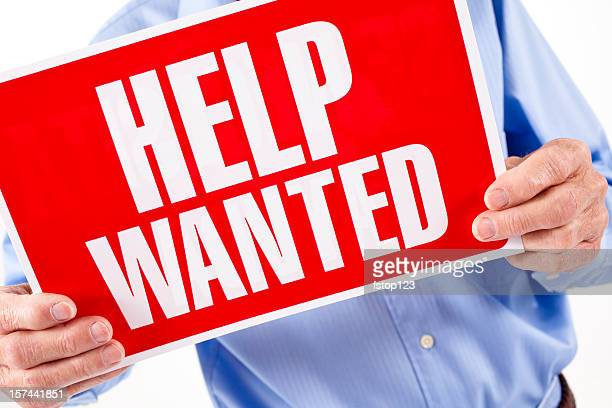 Help Wanted sign. Adult man business owner. Employment. Hiring.