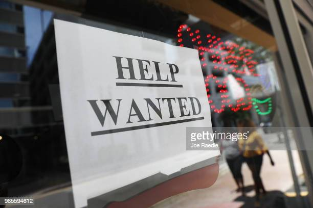 A help wanted sign hangs on a window of a restaurant on June 1 2018 in Miami Florida The US economy gained a strongerthanexpected 223000 jobs last...