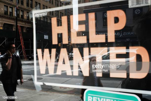 A help wanted sign is displayed in the window of a Brooklyn business on October 5 2018 in New York United States Newly released data by the Labor...