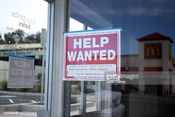 A 'Help Wanted' sign is posted in the window of an automotive service shop on March 8 2013 in El Cerrito California The Labor Department reported...