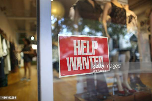 A help wanted sign is seen in the window of the Unika store on September 4 2015 in Miami Florida The US Bureau of Labor Statistics released the...