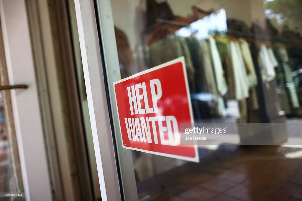 A help wanted sign is seen in the window of the Unika store on September 4, 2015 in Miami, Florida. The U.S. Bureau of Labor Statistics released the August jobs report that shows that the economy created just 173,000 new jobs last month. But the unemployment rate dipped to 5.1%, the lowest since April 2008,