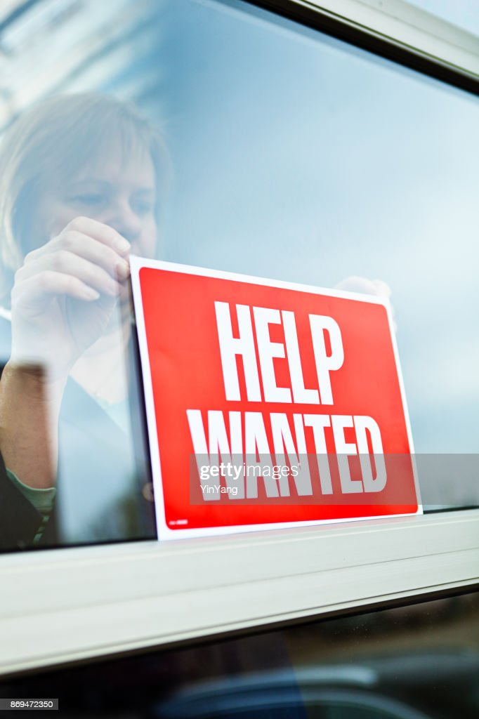 Help Wanted Sign on Retail Display Window for Employment Job Available : Stock Photo
