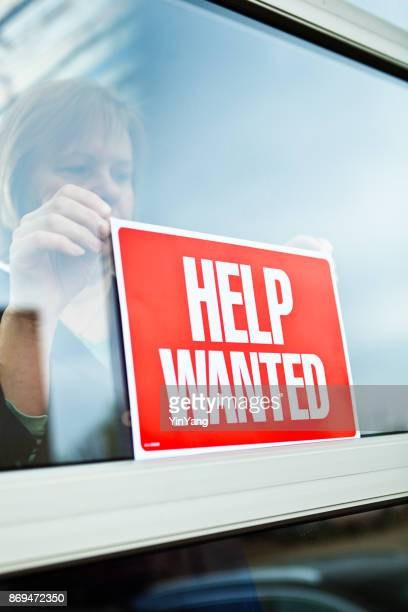 help wanted sign on retail display window for employment job available - help wanted sign stock photos and pictures