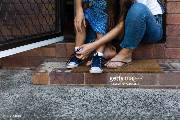 help with school shoes - shoelace stock pictures, royalty-free photos & images