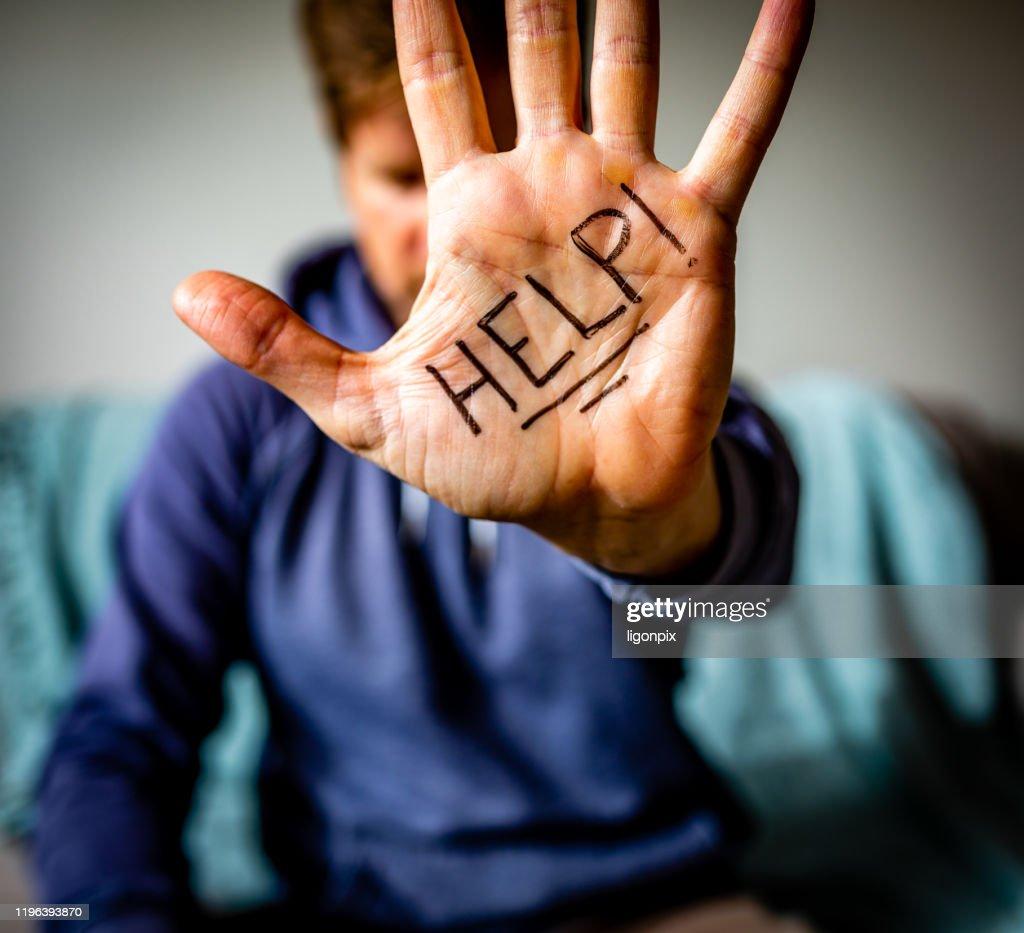 Help Written on Man's Palm : Stock Photo