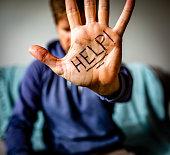 Help Written on Man's Palm