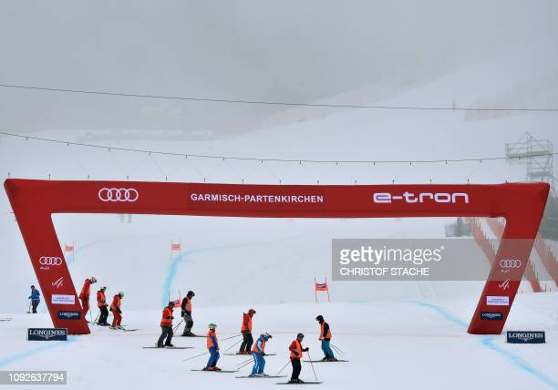Helpers prepare the finish area prior to the men's downhill competition of the FIS Alpine Skiing World Cup in GarmischPartenkirchen southern Germany...