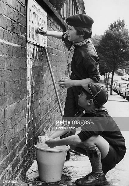 Helpful Boy Scouts clean up Hampstead's road signs in order to collect money for charity 23rd June 1969 Bobby St John Cooper and Patrick Spottiswood...