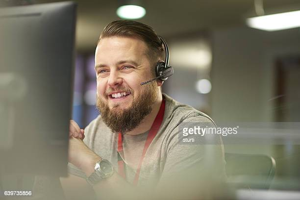 helpful customer service - man in office stock photos and pictures