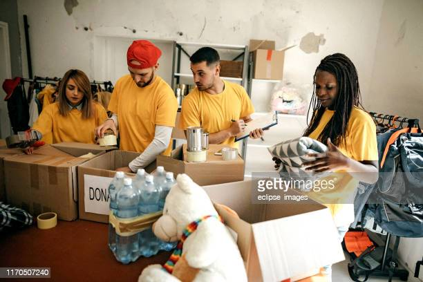helpful team of social workers - charity and relief work stock pictures, royalty-free photos & images