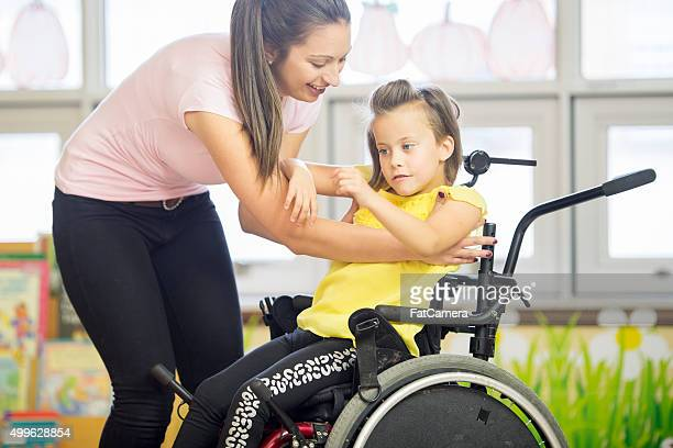 Helping a Child Out of Her Wheelchair