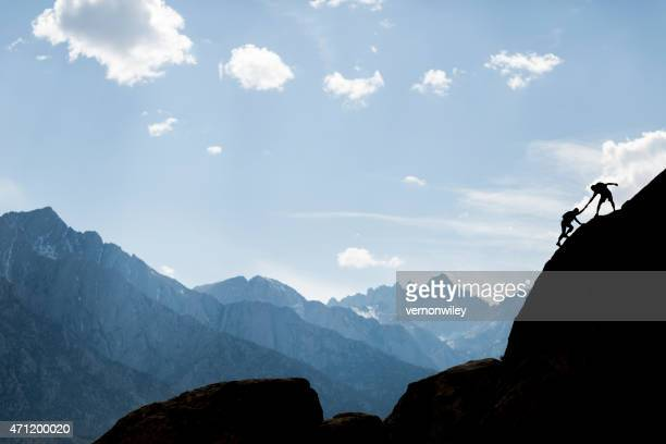 helping climbers - rock climbing stock pictures, royalty-free photos & images