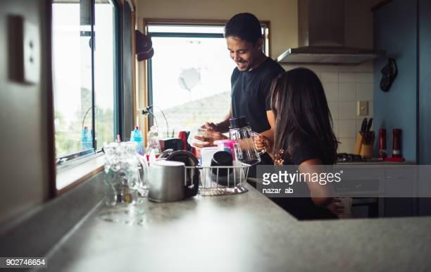 Helping dad in kitchen.