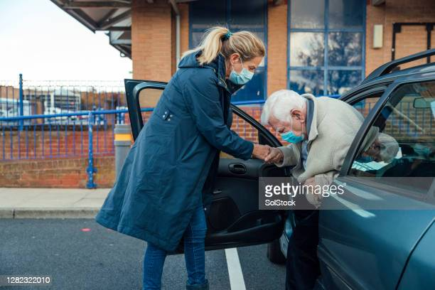 helping dad out of the car - support stock pictures, royalty-free photos & images