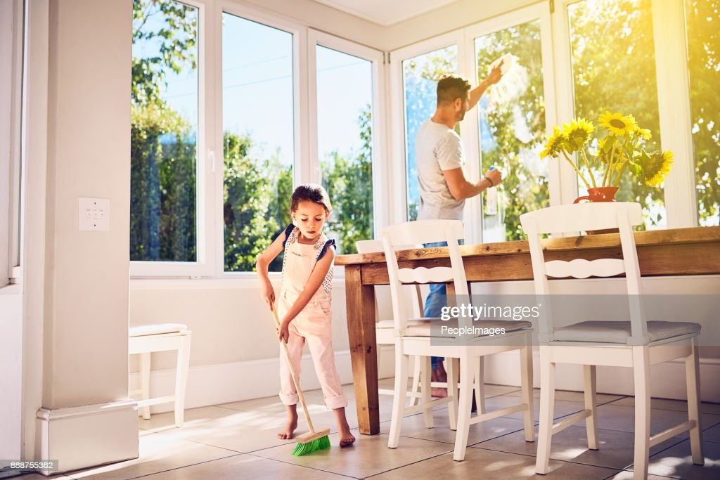 Helping Dad with some spring cleaning around the house : Stock Photo