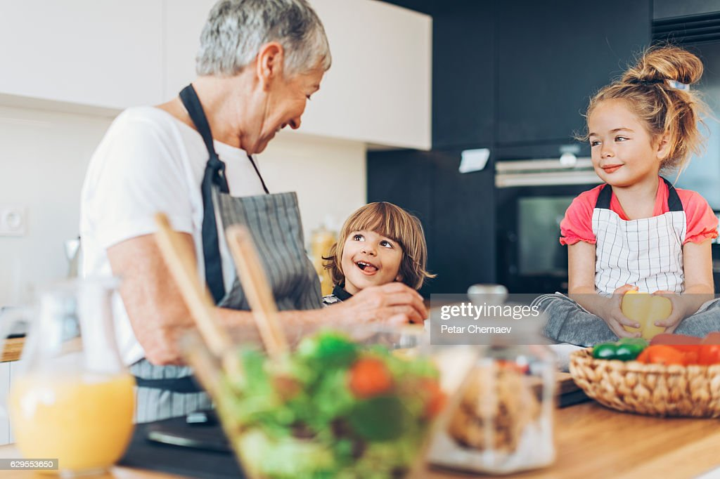 Helping grandma in the kitchen : Stock Photo