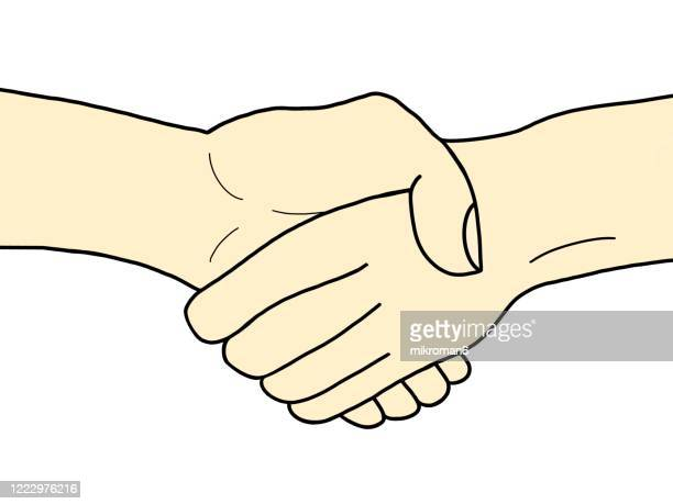 a helping hand concept, handshakes - handshake stock pictures, royalty-free photos & images