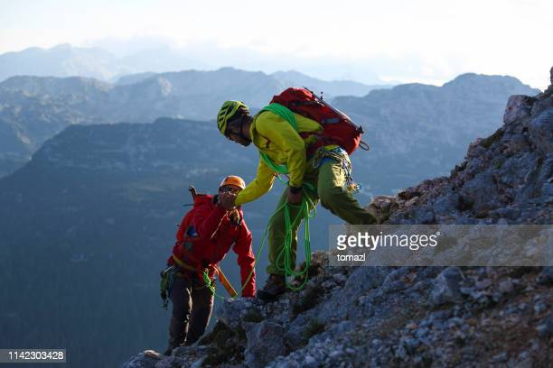 helping hand in the mountains - rescue stock pictures, royalty-free photos & images