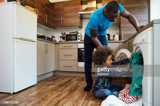 a helping hand - washing machine stock pictures, royalty-free photos & images