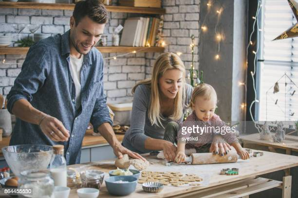 helping hands in kitchen - baking stock pictures, royalty-free photos & images