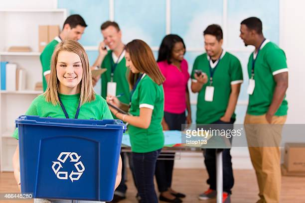 Helping Hands!  Volunteers collaborate to organize recycling campaign.
