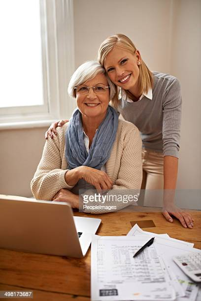 helping her grandmother make sense of any financial problem - grandma invoice stock pictures, royalty-free photos & images