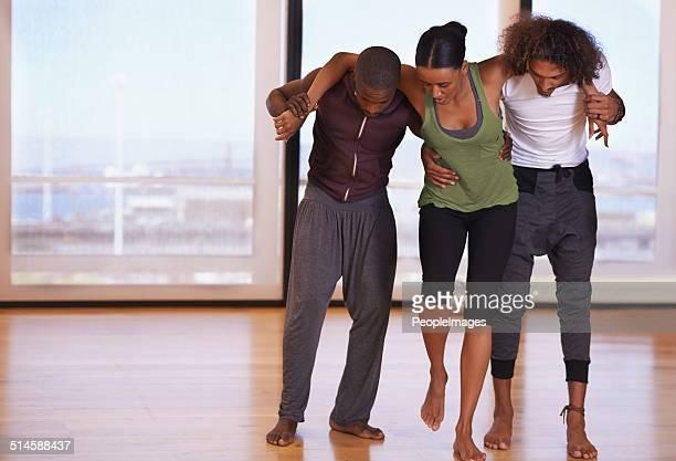helping her off the studio floor - black men feet stock photos and pictures