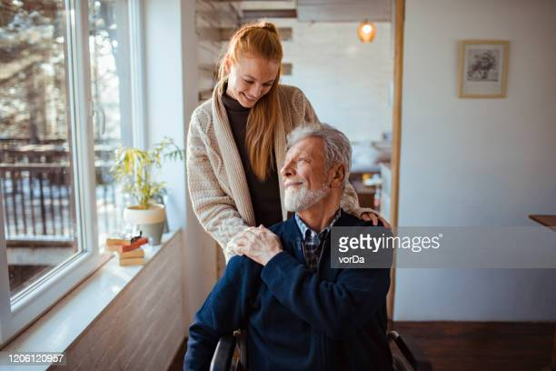 helping her old man - healthcare worker stock pictures, royalty-free photos & images