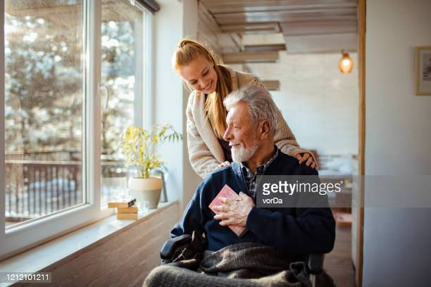 helping her old man - senior adult stock pictures, royalty-free photos & images
