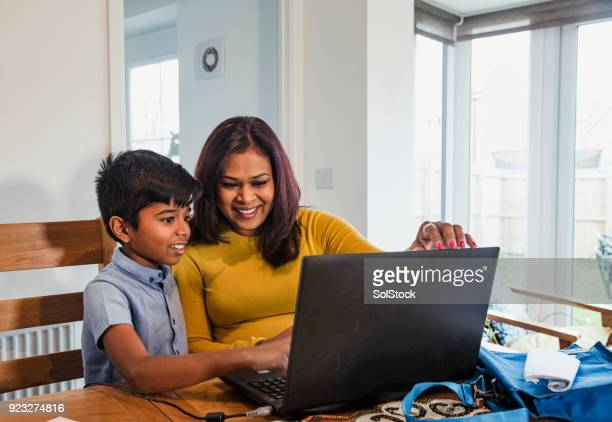 helping her son with his homework - bangladesh mother stock pictures, royalty-free photos & images