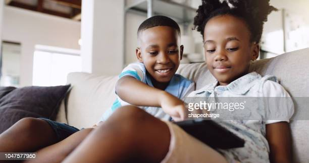 helping her work her tablet - using digital tablet stock photos and pictures
