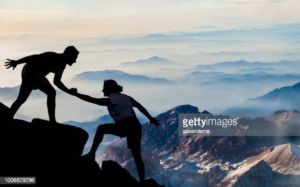 helping hikers - trust stock pictures, royalty-free photos & images