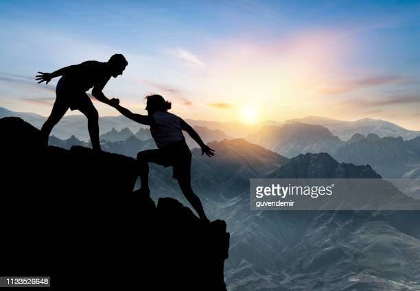 helping hikers - mountain climbing stock pictures, royalty-free photos & images