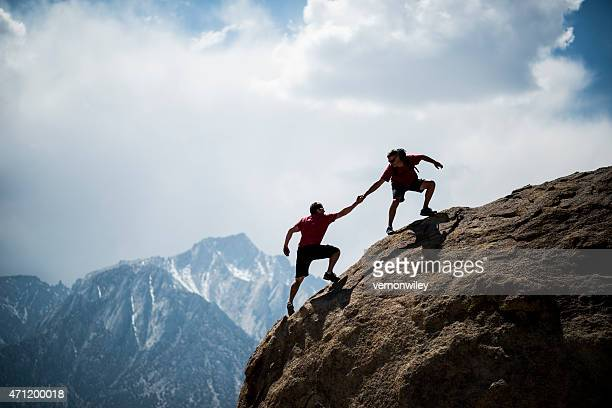 helping hikers - mountaineering stock pictures, royalty-free photos & images