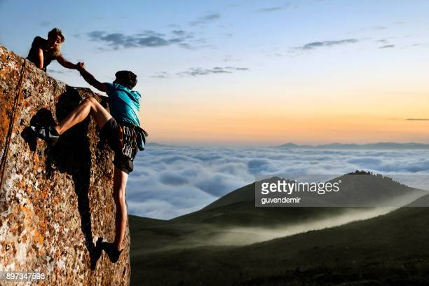 helping hikers - mountain peak stock pictures, royalty-free photos & images