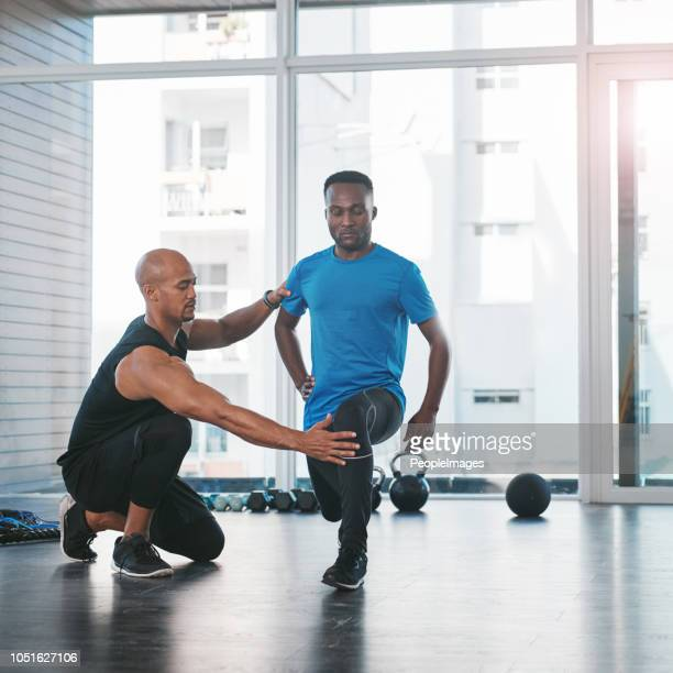 helping him to achieve his fitness goals - fitness instructor stock pictures, royalty-free photos & images