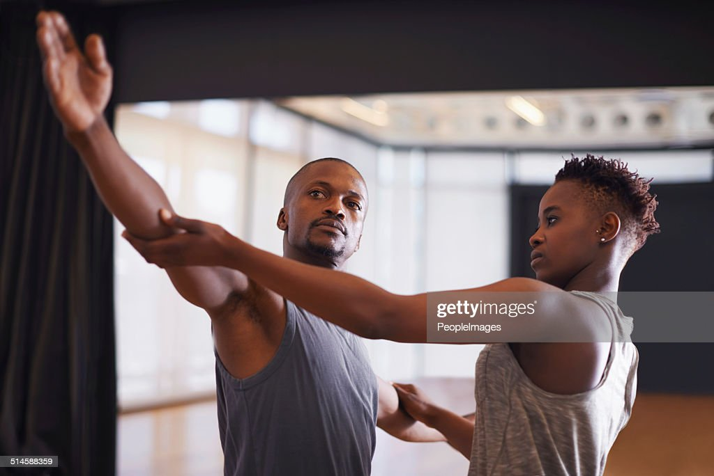 Helping him with his posture : Stock Photo