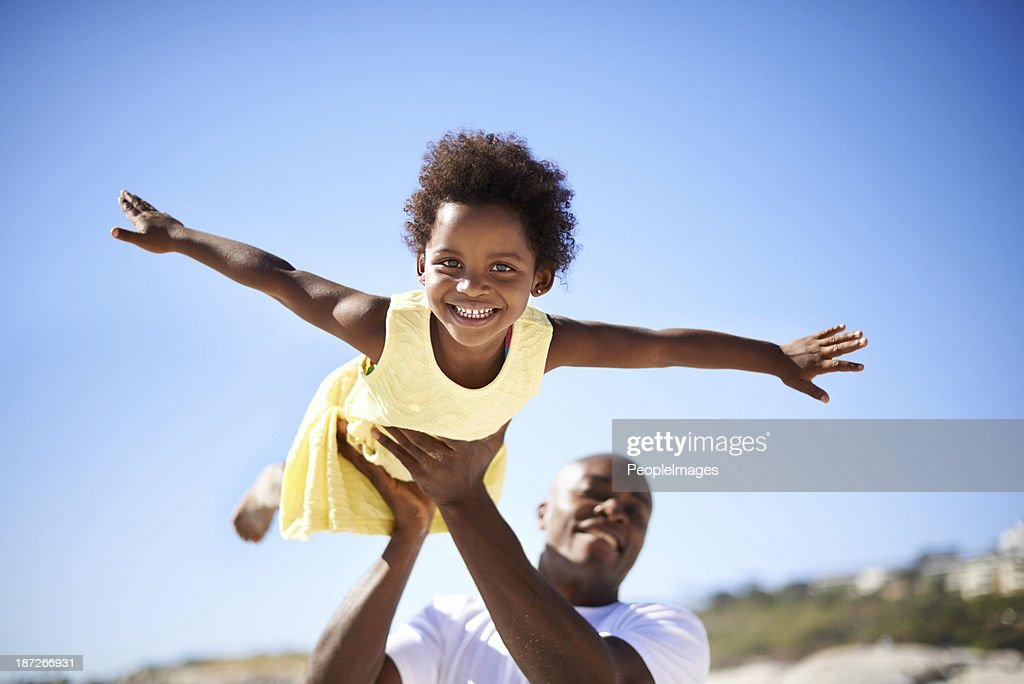 Helping his daughter soar! : Stock Photo