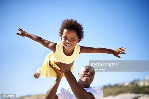 Helping his daughter soar!