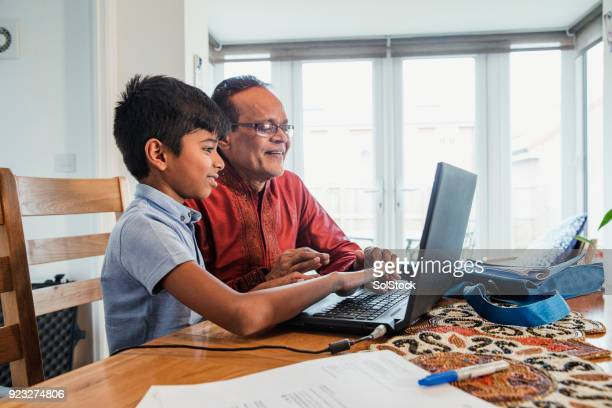 Helping his Grandson with Homework