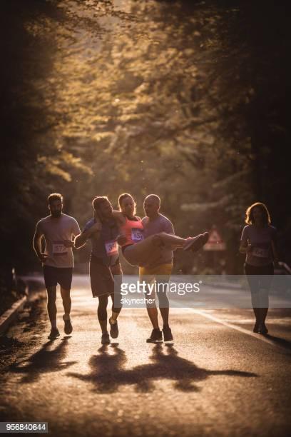 Helping injured athlete on marathon race!