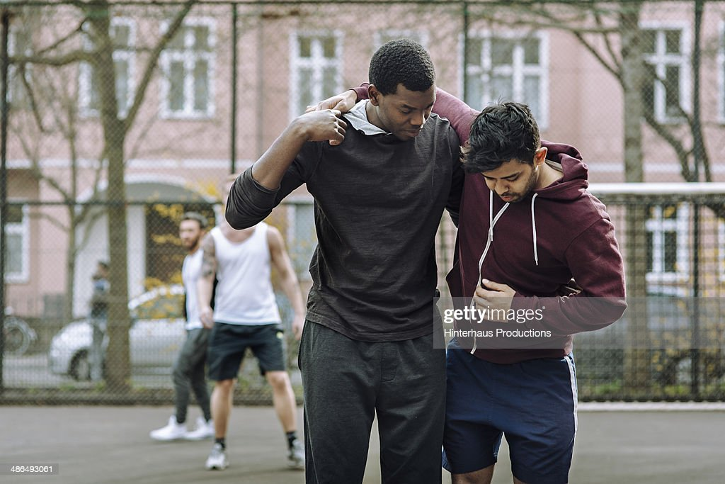Helping Injured Team Mate : Stock Photo
