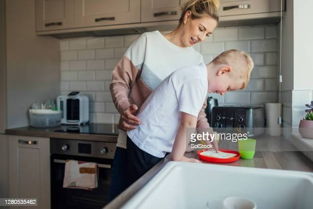 helping mum make lunch - plastic plate stock pictures, royalty-free photos & images