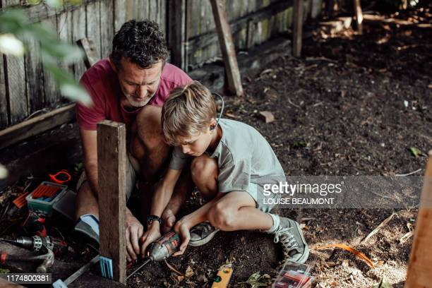 helping out dad - lifestyle stock pictures, royalty-free photos & images