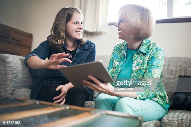 Helping Senior Woman With Technology