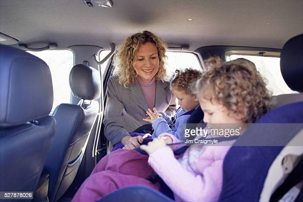 Helping Twin Daughters with Car Seats