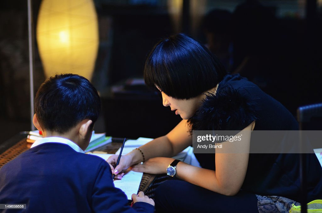 Helping with homework : Stock Photo