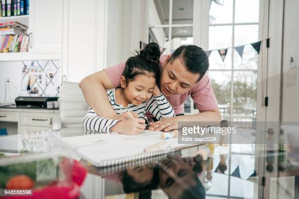 helping with homework - genderblend stock pictures, royalty-free photos & images